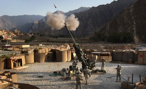 Artillerymen fire a 155mm Howitzer at a Taliban position October 22, 2008 from Camp Blessing in the Kunar Province of eastern Afghanistan. (John Moore/Getty Images)
